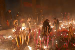 new year money burning new year sees fortune seekers flock to temples for