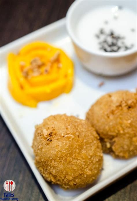 New Chitato Beef Rendang Mango Sticky Rice Fried Crab Egg Yolk nav modern thai spices it up with new dishes