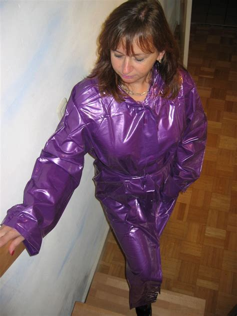 lade in pvc pvc rainwear in a shiny purple raincoat