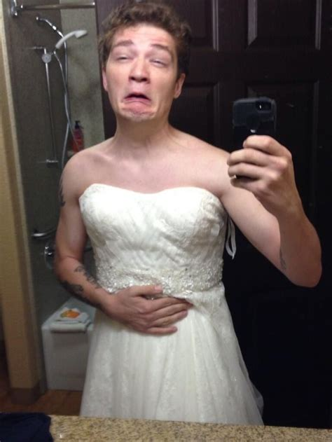 A Roster Dress michael wearing the wedding dress the next morning
