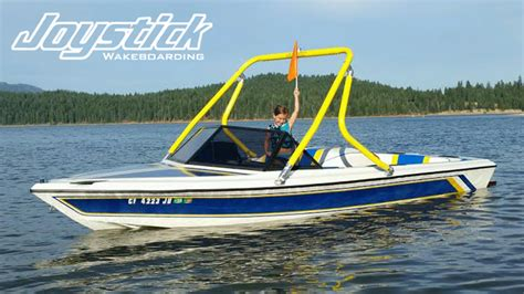 yellow wake boat malibu towers joystick wakeboard towers