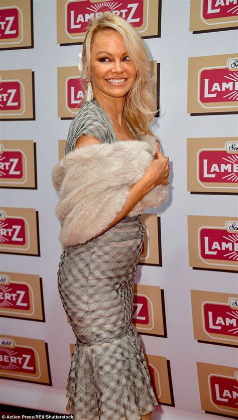 Pam Andersons Fur Fury by Showcases Assets In Plunging Dress Daily