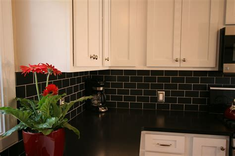white cabinets black subway tile black granite