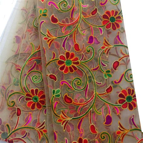 embroidery and on fabric beige net fabric with multicolour kutch embroidery