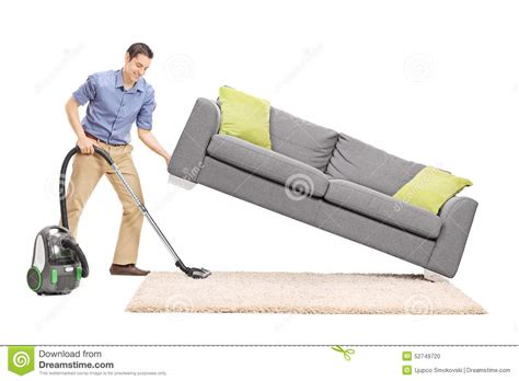 vacuum cleaner for sofa man lifting a sofa and vacuuming underneath it stock photo