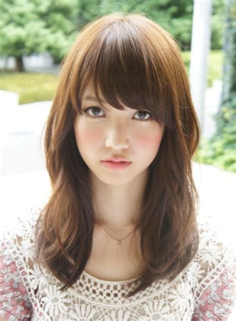 chinese ball with bang hair style medium length loose waves with bangs http www hothair co