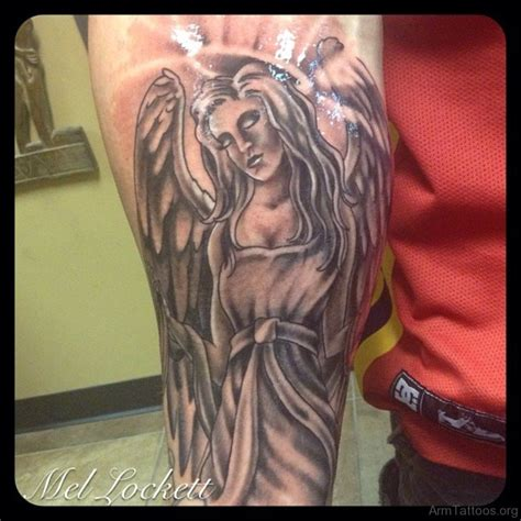 angel tattoo in arm 38 ultimate angel tattoos for arm
