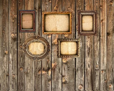 set  empty picture frames  wooden wall stock photo