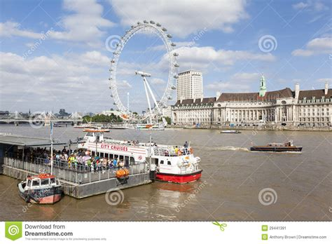 thames river cruise london eye pier westminster pier and river thames in london uk editorial