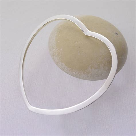 sterling silver heart shaped bangle by lily charmed   notonthehighstreet.com
