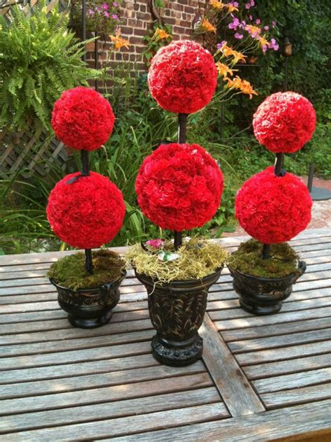 topiary table centerpieces loving these topiaries for wedding reception table