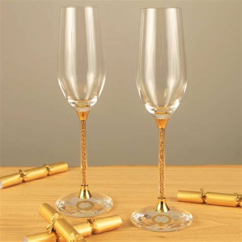 party glasses swarovski crystal pair of chagne flutes with gold swarovski crystals by