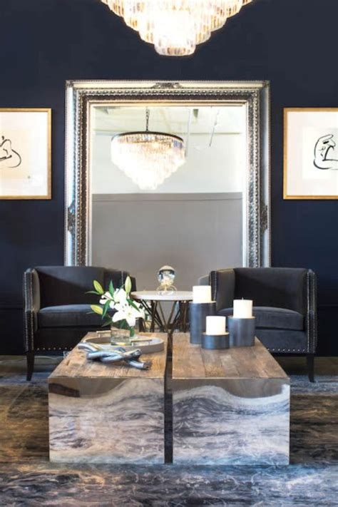 Superior How To Design A Rectangular Living Room #3: Blue-walls-look-sassy-with-this-large-silver-framed-mirror.jpg