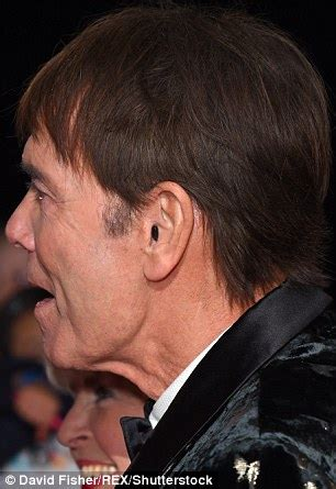 wraring hearing aid washed hair sir cliff richard spotted wearing hearing aid in public