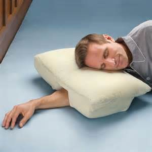 sleeping without pillow arm sleeper s pillow helps ward off sleep disorders