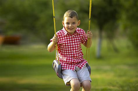 swinging children free photo boy swinging playing swing free image on