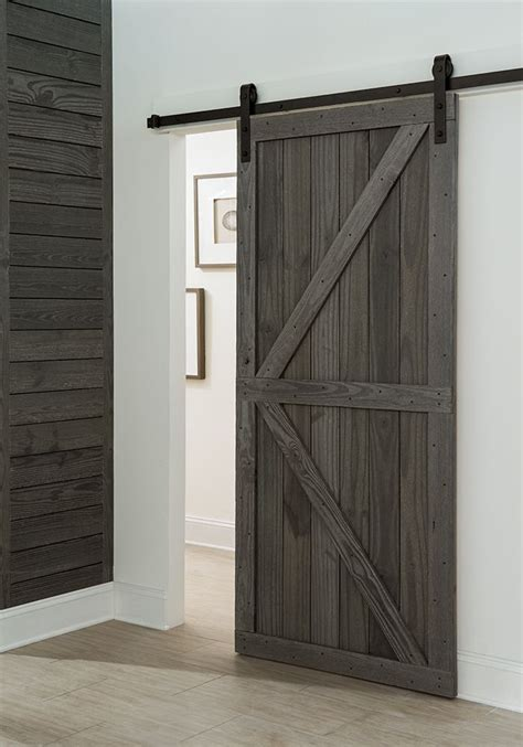 sliding barn door get a farmhouse look with a barn style sliding door in