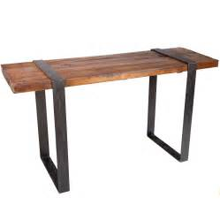Table with wrought iron base and steel strap legs and hammered copper