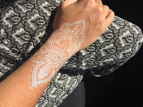 henna inspired temporary tattoo these white henna inspired temporary tattoos are gorgeous