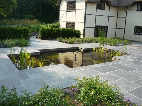 Formal pond one year on Pete Sims Garden Design