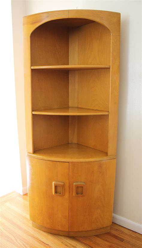 free standing corner cabinet brown wooden pantry cabinet with four shelves having