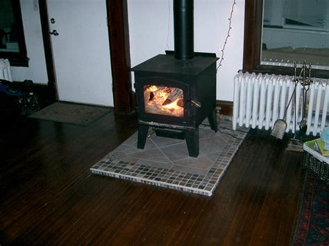 can you put a wood stove in a fireplace how to install a wood stove