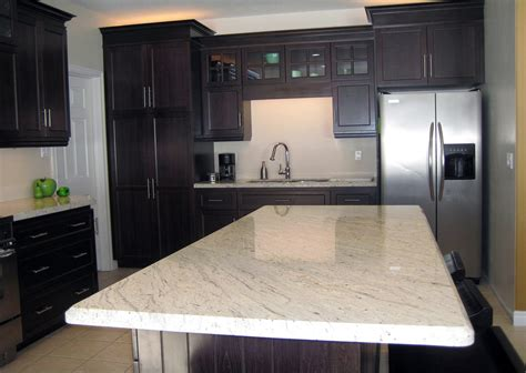 what color granite with white cabinets and dark wood floors river white granite
