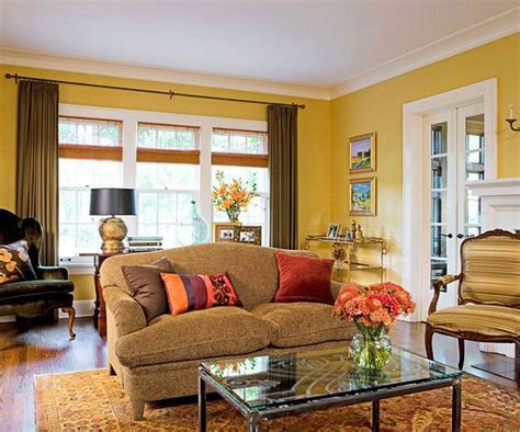 yellow color schemes high ceilings artworks and accent pillows