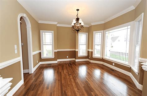 painting living room walls two colors chair rail molding and two tone paint design build pros