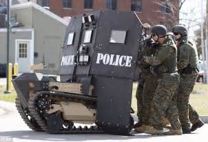 Armored shields: A SWAT robot, a remote controlled small tank like vehicle with a ballistic