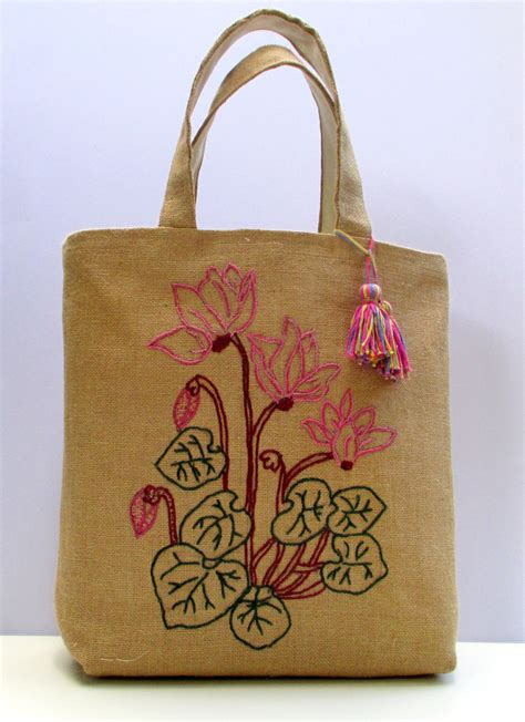 Handmade Bags Designs - embroidered jute tote bag with cyclamen flowers handmade one