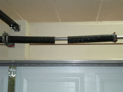 One Torsion Spring Vs Two Torsion Springs On A 2 Car 16 Garage Door Broken Torsion
