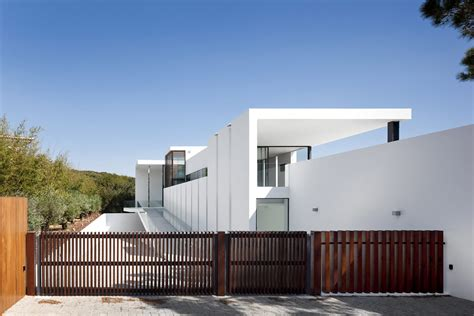 a beach house in portugal goes modern design milk entrance gates modern home with a unique suspended pool