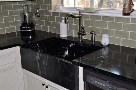 black countertop with black sink the best kitchen sinks 9 materials you will