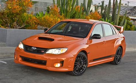 subaru wrx sti orange car and driver