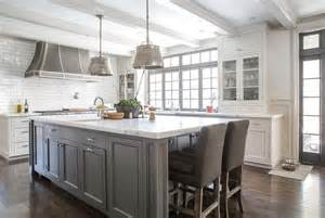 gray kitchen island white kitchen island with gray velvet counter stools transitional kitchen