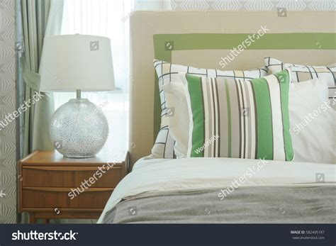 table next to bed reading l on bedside table next stock photo 582405187