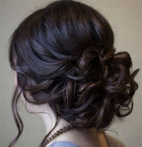 soft updo hairstyles beautiful low prom updo hairstyle with loose soft curls