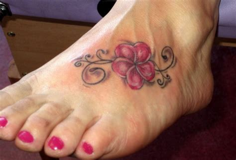 small colorful hawaiian flower tattoo on foot