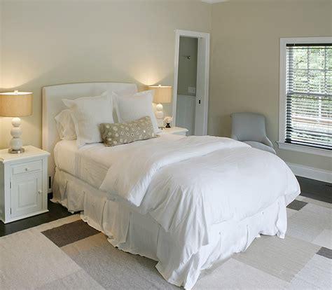 white slipcovered headboard transitional bedroom