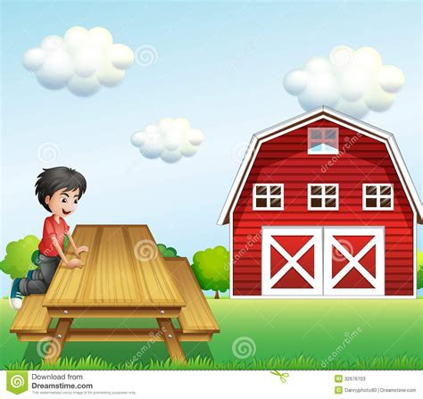a boy at the table near the barnhouse stock photos image