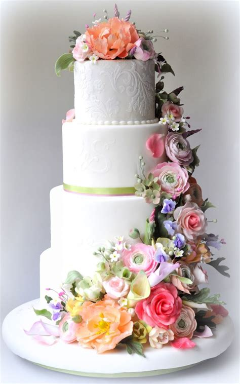 25 delightful wedding cakes with cascading florals onewed