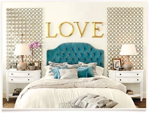 blue white and gold bedroom blue velvet headboard white bedding gold accents in this