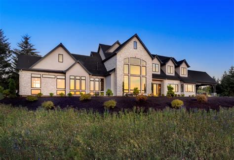 beautiful luxury home exterior at with sunset