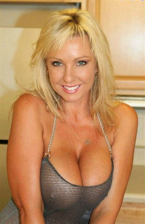 the best mature pierced nipple blond milf in metallic mesh top and great