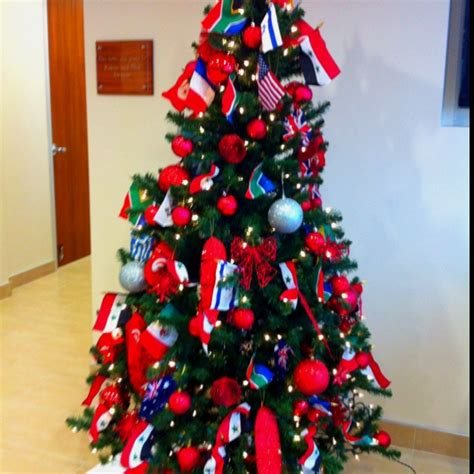 international christmas tree decorated with flags from