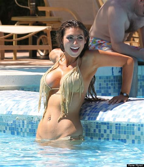 luisa zissman nearly falls out of her very low cut dress luisa s bikini break video game review 2013