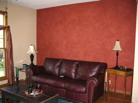 i used behr eggshell classic taupe as a color with an accent wall in rowan berry ralph