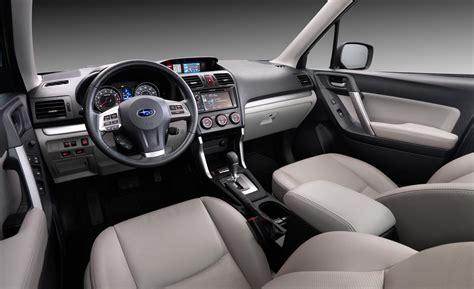 white subaru forester interior car and driver