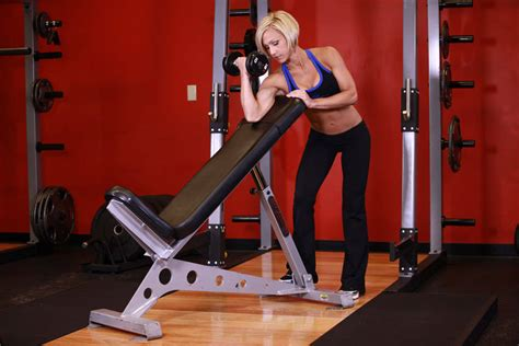 standing one arm dumbbell curl incline bench exercise